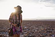 Chile, San Pedro de Atacama, woman in the desert in backlight - MAUF000613