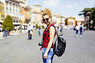 Italy, Verona, smiling woman in the city - GIOF001052