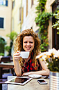 Portrait of smiling woman at outdoor cafe - GIOF001082
