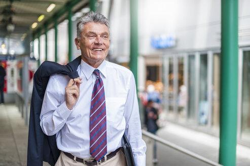 Smiling senior businessman in the city - DIGF000552