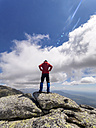 Spain, Sierra de Gredos, hiker standing on rock in mountainscape - LAF001655