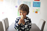 Portrait of cross-eyed little boy with ice cream cone - VABF000510
