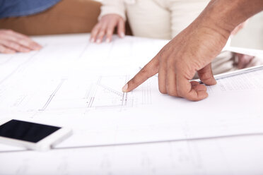 Hand pointing on construction plan - MFRF000673