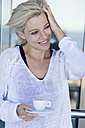 Mature woman with a cup of coffee, during cruise - ONBF000001