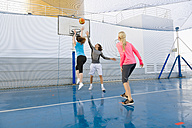 Three people playing basketball on a deck of a cruise ship - ONBF000015