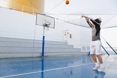 Young man playing basketball on a deck of a cruise ship - ONBF000018