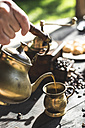 Pouring coffee into vintage coffee cup - DEGF000802