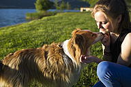 Italy, Lecco, teenage girl with her dog - MRAF000058