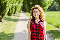 Portrait of smiling woman enjoying nature - GIOF001129
