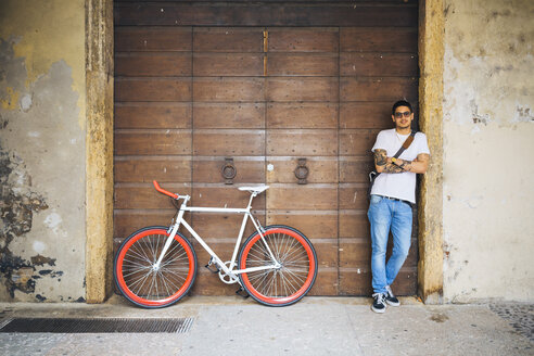 Young man with a bicycle in the city - GIOF001161