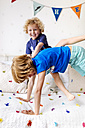 Little boy playing with his big brother at home - MGOF001906