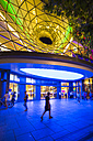Germany, Frankfurt, lighted entrance of shopping centre by night - TAM000489