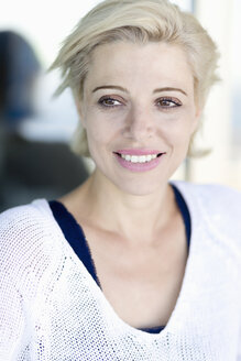 Portrait of smiling blond woman - ONBF000031