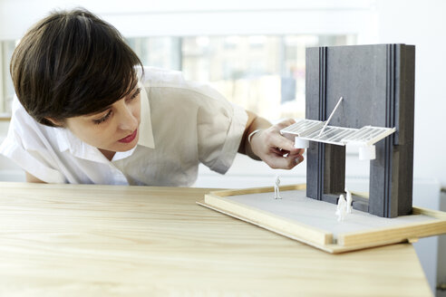 Woman checking architectural model - TSFF000057
