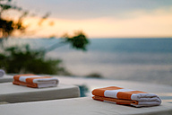 Towels on sun loungers by the sea - ABAF002024