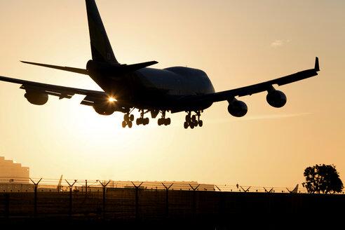 Jet landing at sunset - JLRF000044
