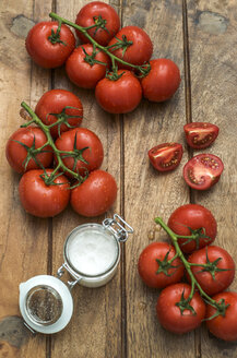 Vine tomatoes and glass of sea salt on wood - ODF001378