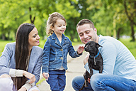 Happy family with dog in park - HAPF000492