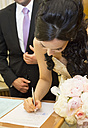 Bride signing document in register office - FCF000968