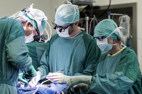 Heart surgeons and operating room nurse during a heart valve operation - MWEF000051