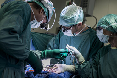 Heart surgeons and operating room nurse during a heart valve operation - MWEF000054