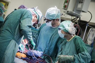 Heart surgeons and operating room nurse during a heart valve operation - MWEF000066
