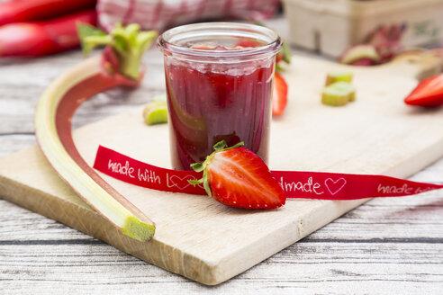 Glass of homemade strawberry rhubarb jam - LVF004900