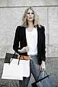 Portrait of serious looking woman with many shopping bags - GDF001000
