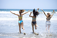 Three friends running in the sea - ABAF002031