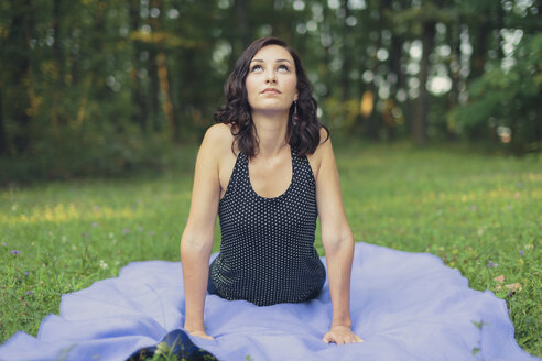 Croatia, Woman practicing yoga in the woods, yoga in nature - LCU000003