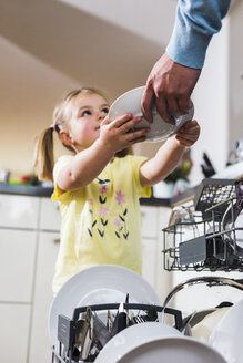 Daughter helping father clearing dishwasher - UUF007446