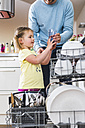 Daughter helping father clearing dishwasher - UUF007452