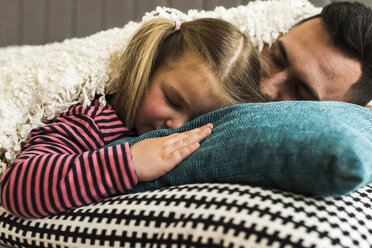 Father and daughter sleeping on cushion - UUF007461
