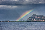 Italy, Sicily, Province of Trapani, climbing rock Monte Monaco, stormy atmosphere and rainbow - HWOF000112