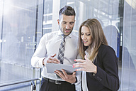 Businessman and businesswoman with digital tablet - MADF000879