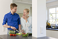 Couple in kitchen preparing a salad - SHKF000602