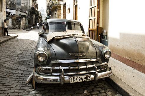 Cuba, Havana, parking black vintage car on a road in the old town - MAB000367