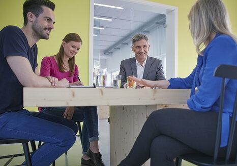 Business people having a meeting in board room - RHF001517