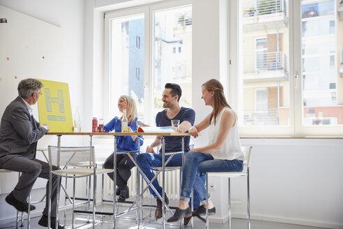 Business people having a meeting in board room - RHF001529