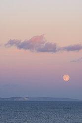UK, Dorset, full moon at sunset - RUEF001707