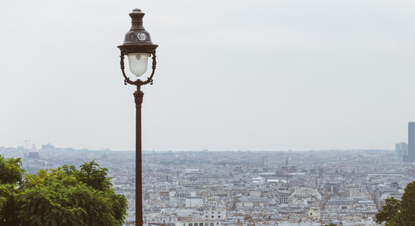 France, Paris, a lamp and cityscape - LCU000013
