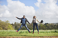 Happy couple jumping in the air - JCF000048