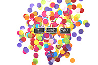I love you wrote in tweezers above confetti white background - JCF000057