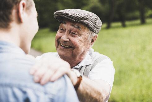 Portrait of happy senior man with his grandson - UUF007602