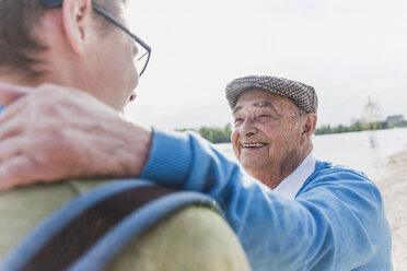 Portrait of smiling senior man with his grandson - UUF007635