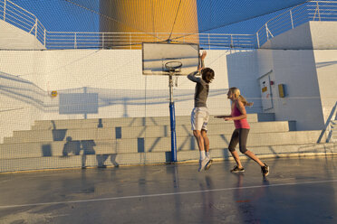 Couple playing basketball on a deck of a cruise ship - ONBF000045