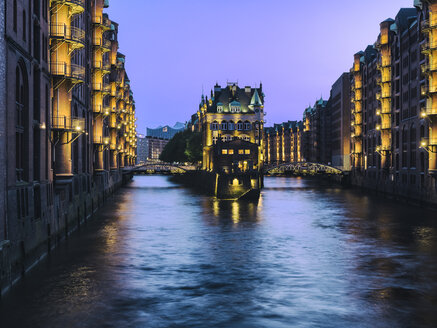 Germany, Hamburg, view to lighted Old Warehouse District at blue hour - KRPF001762