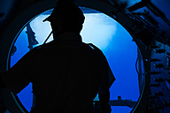 Pilot in cockpit of a submarine - NG000327