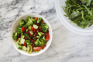 Ingredients of salad in a bowl on white marble - EVGF002972