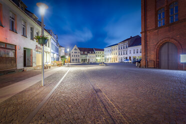 Germany, Brandenburg, Perleberg, Market square in the historic old town at night - NKF000462